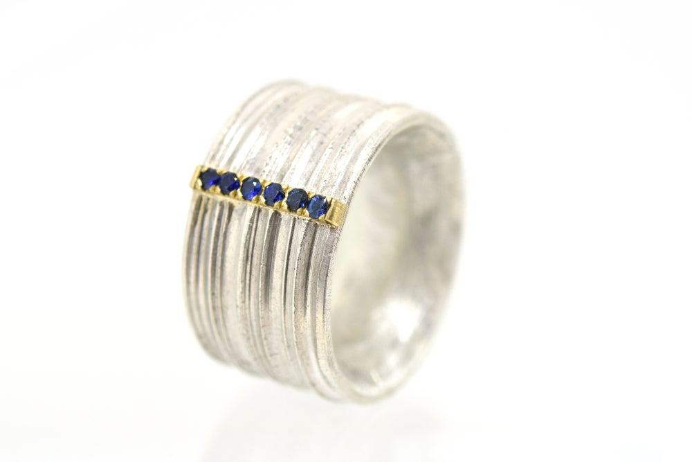 Image of Wide band Strata ring set with sapphire. Sterling silver and 18ct gold