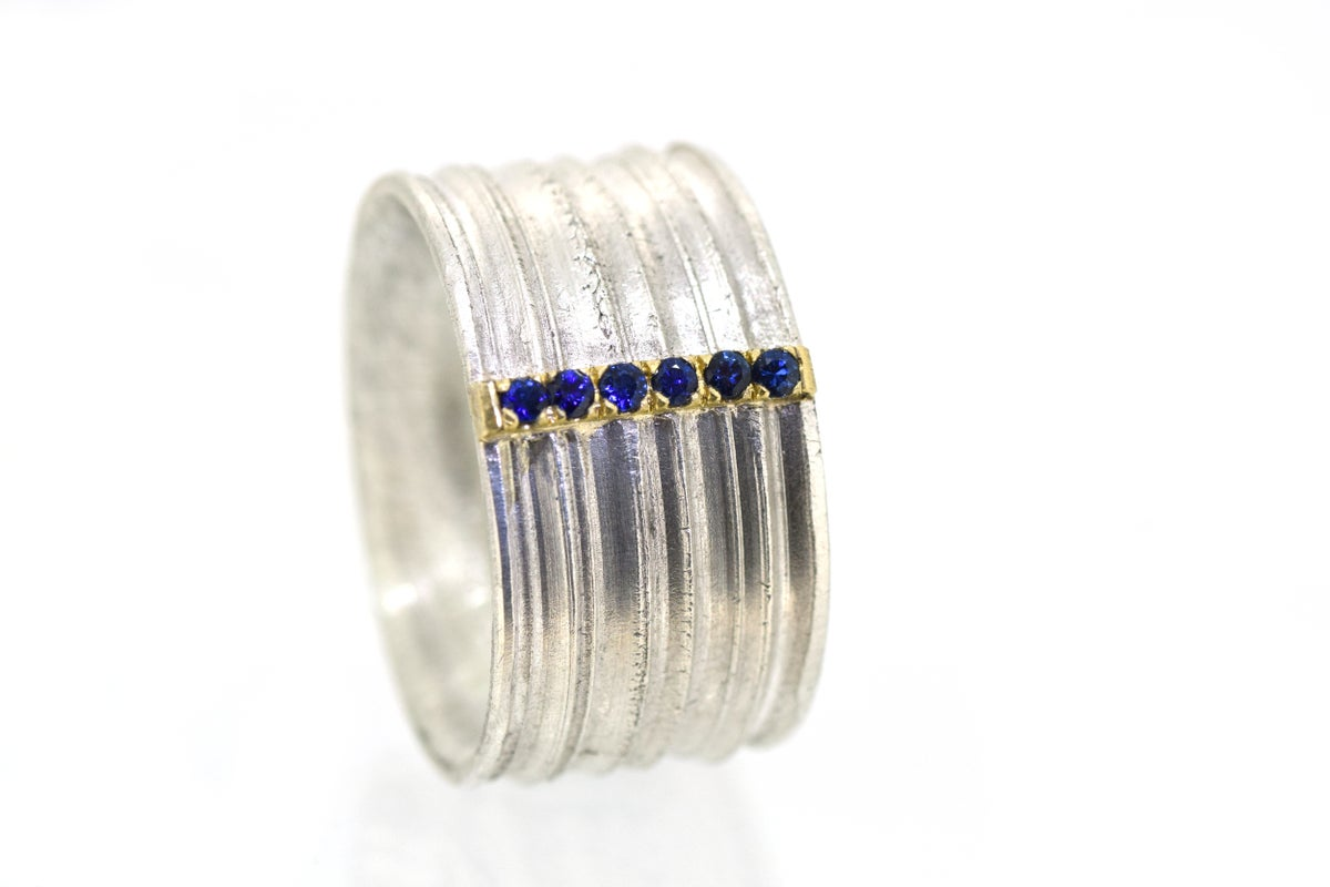 Wide band Strata ring set with sapphire. Sterling silver and 18ct gold