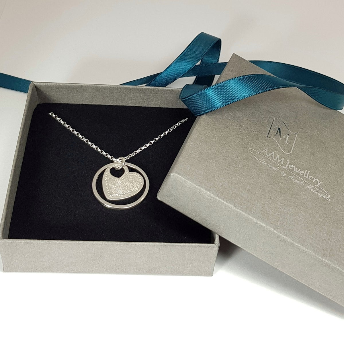 Image of Sterling Silver Heart and Circle Pendant Necklace