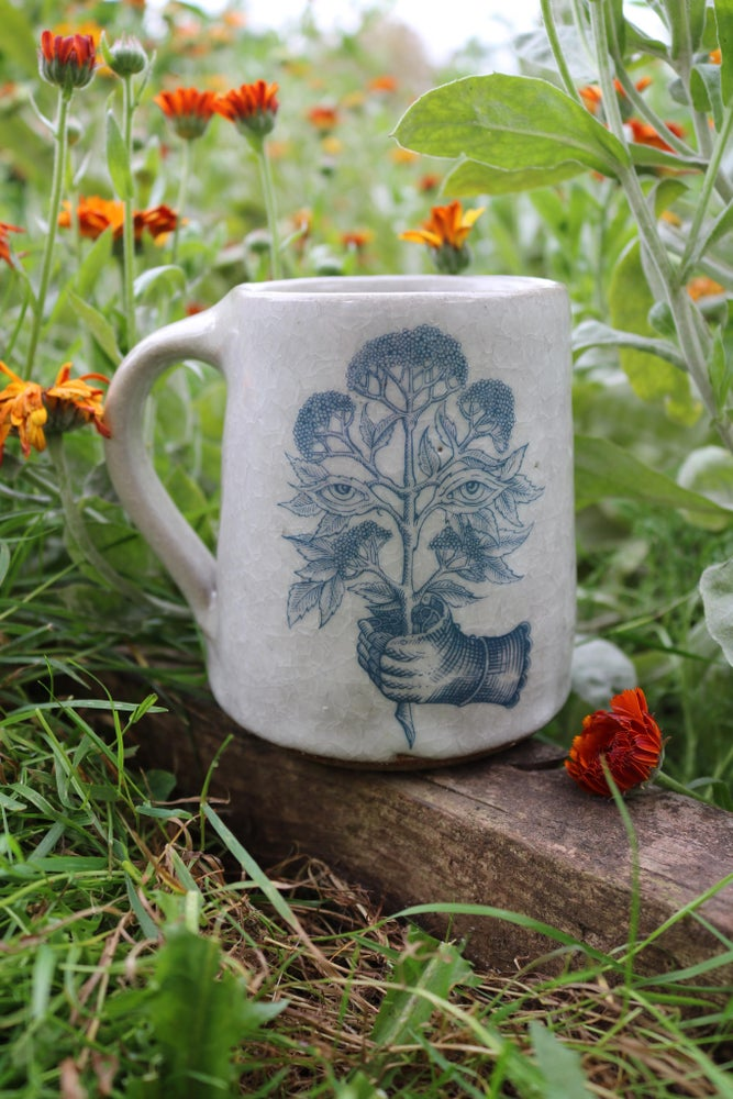 Image of From the soil to the moon. Ceramic tankard.