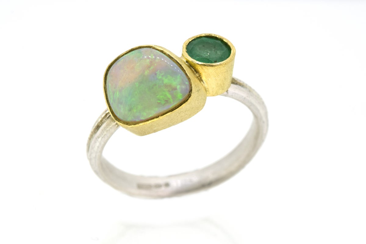 Emerald and pipe opal ring in 18ct gold and silver. By Chris Boland