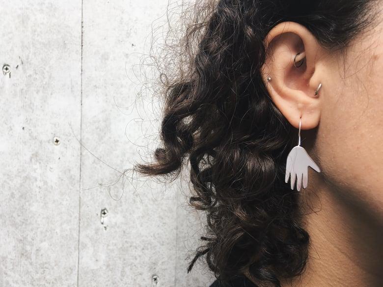 Image of hand drop earrings