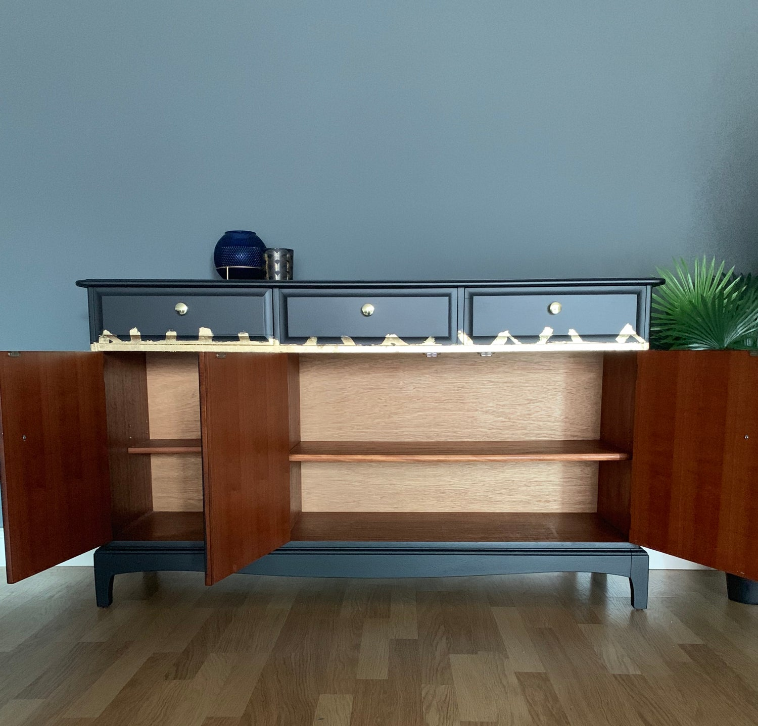 Image of A stunning black & gold leaf stag mahogany sideboard