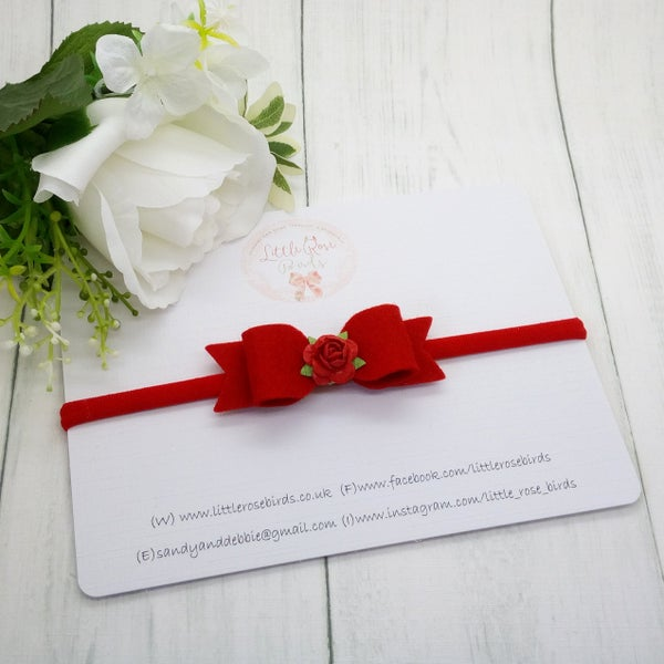 Image of Red Bow with Flower