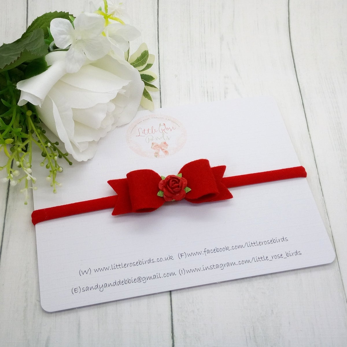 Image of Small Red Bow with Flower