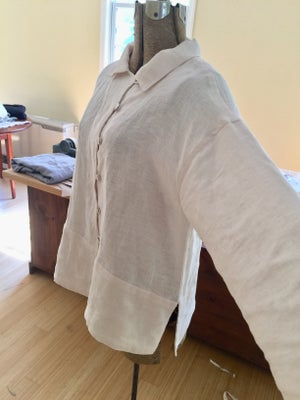 Image of fancy blouse in soft peach linen