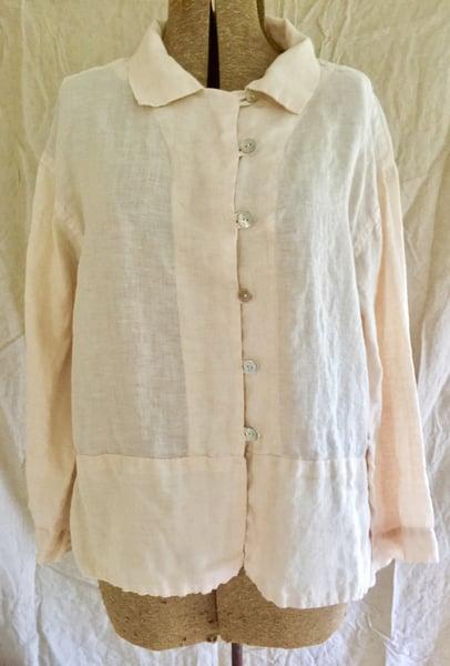 Image of fancy blouse in soft peach linen