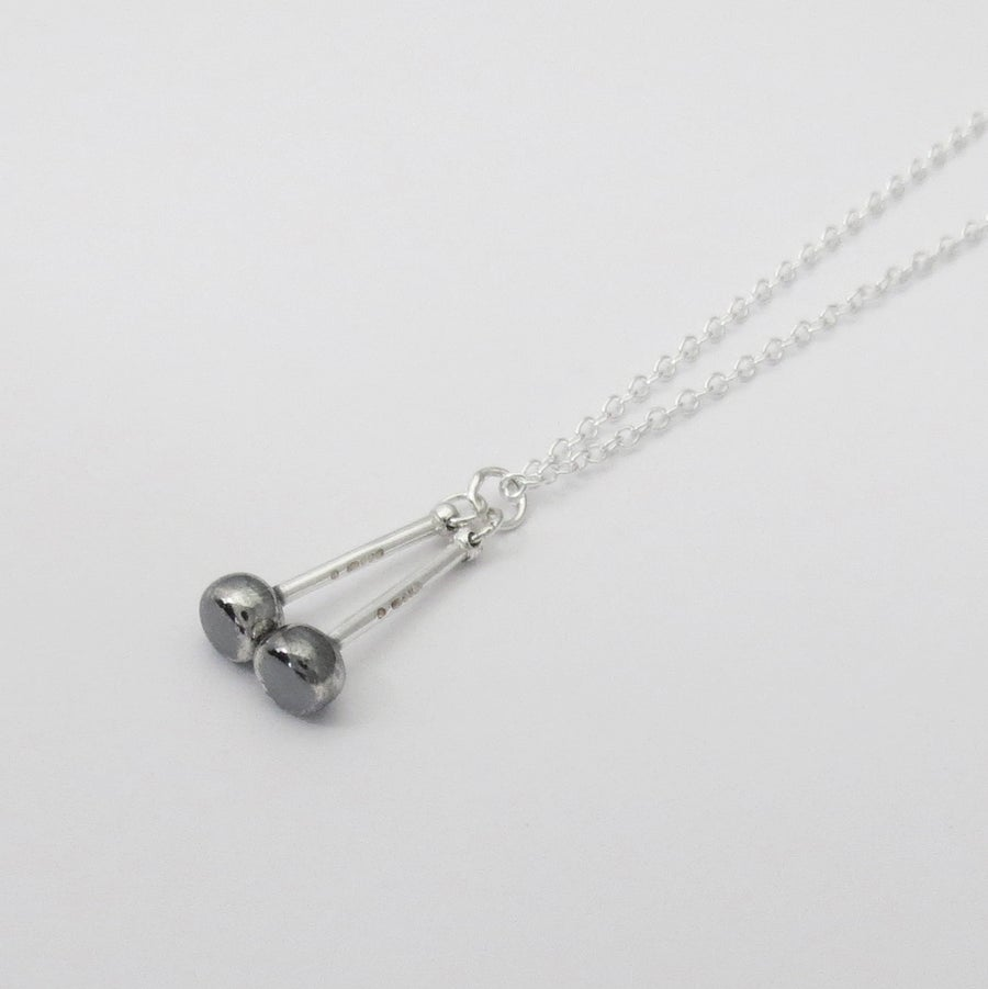 Image of Silver and Black Tenor Sticks Pendant