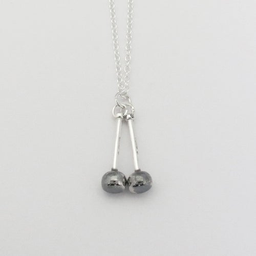Image of Silver and Black Tenor Sticks Pendant