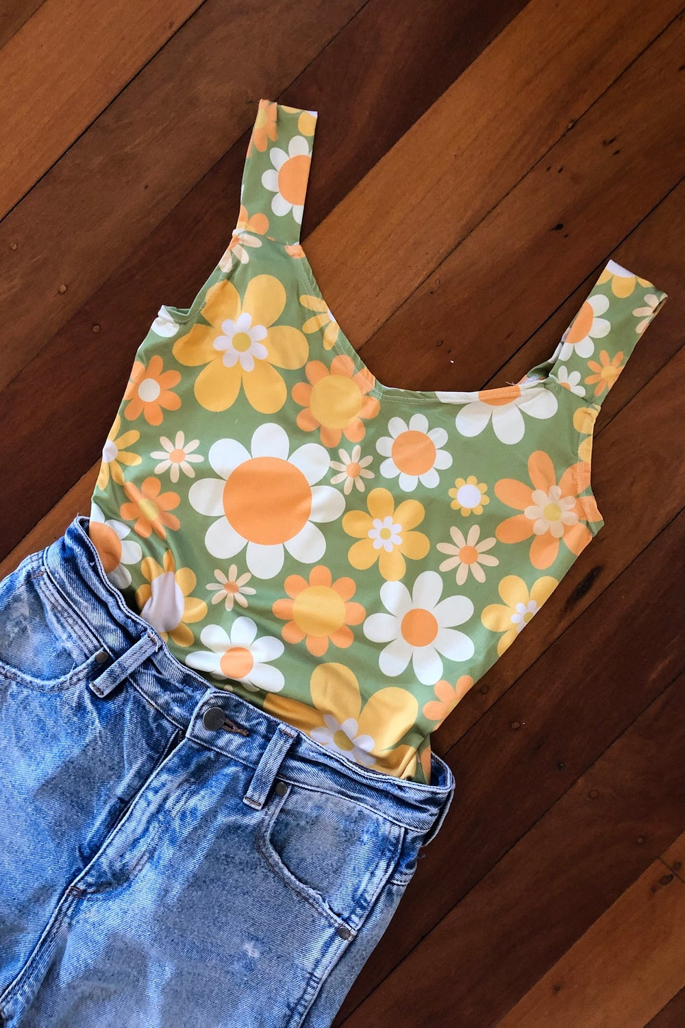Boogie nights bodysuit in our Sunny side up print green