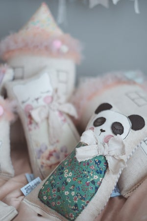 Image of Panda in green floral liberty with natural linen bow