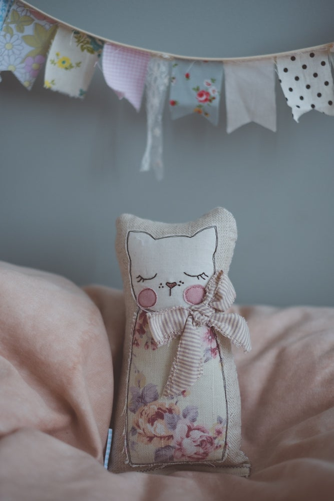 Image of Kitty in vintage floral with stripe bow