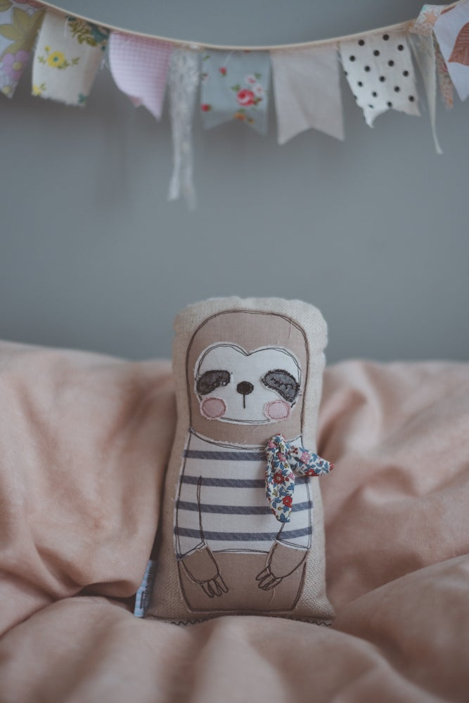 Image of Sloth in french stripe shirt and liberty neck tie