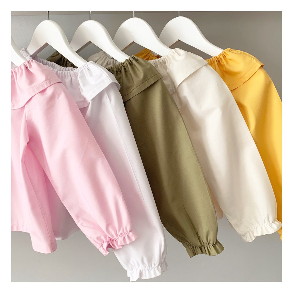 Image of Plain colour ruffle neck blouses