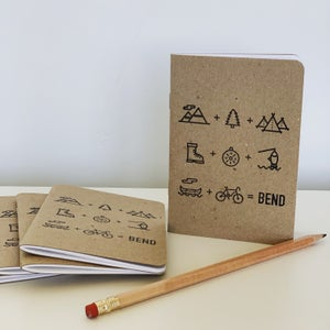 Image of  Bend Equation pocket notebook blank pages kraft cover