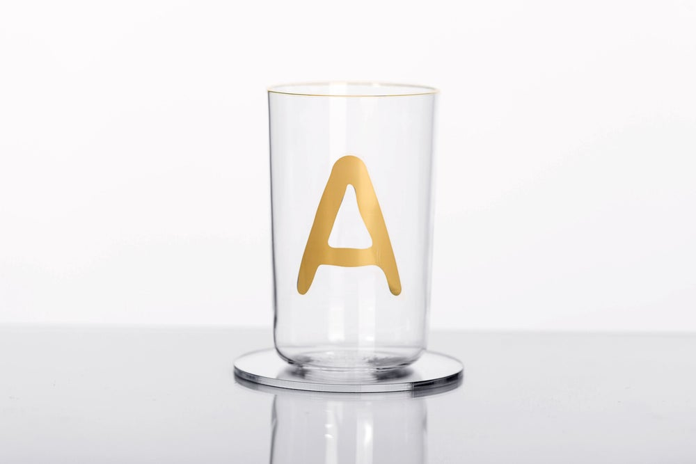 Image of VERBA water glass with Latin letter in gold