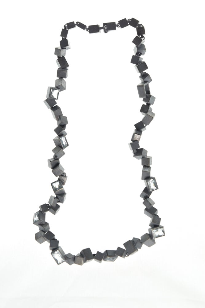 Image of Intersecting Cube Necklace. Aquamarine set in oxidised silver