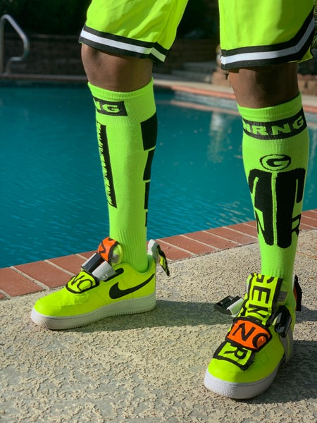 Image of Knee length soccer socks in neon yellow