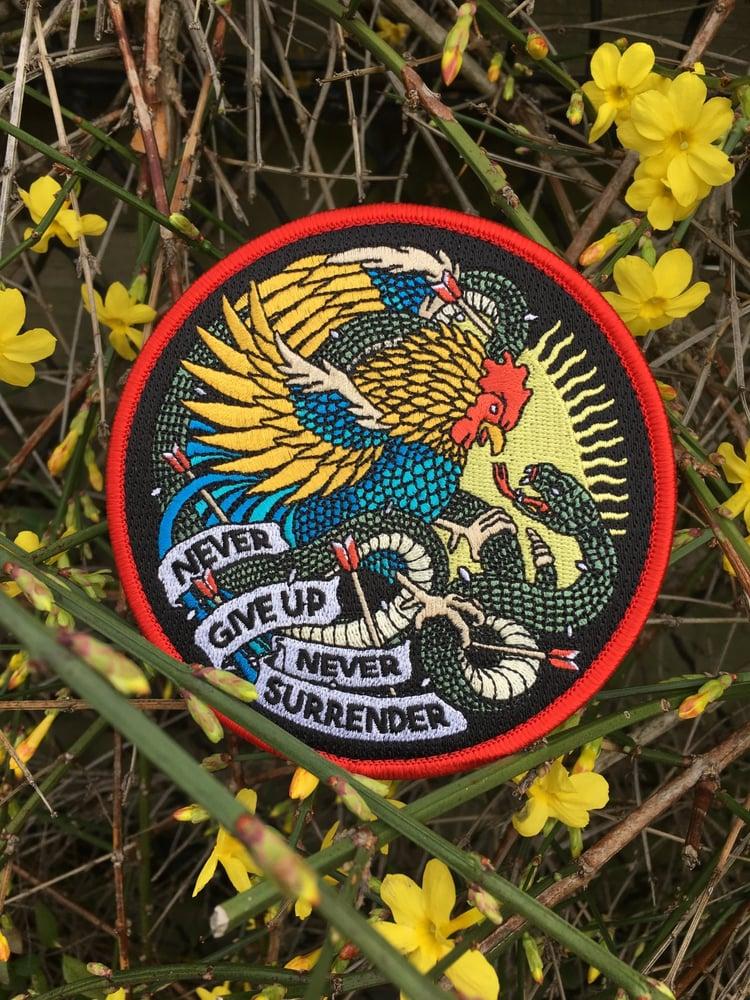 Image of Never Give Up Never Surrender #1 - Rooster vs Snake