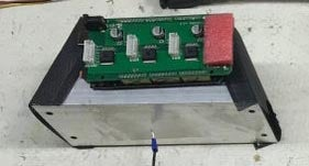 Image of TLE5206 with Arudino Board, heatsinks, power supply and plastic holder