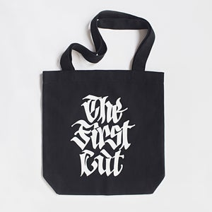Image of 'THE FIRST CUT' tote bag