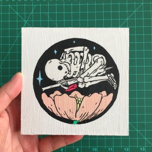 Image of Skeleton over Flower Painting