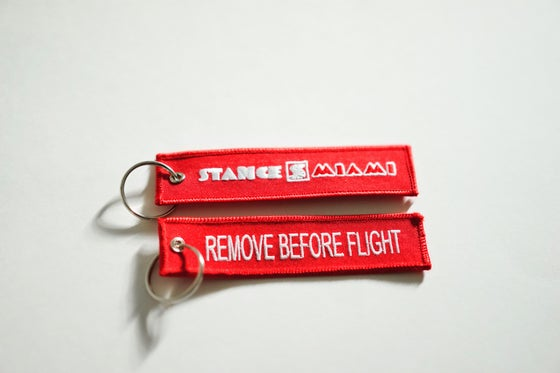 Image of Red Flight Tag w/ Free Sticker