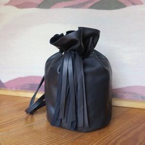 Image of matte black Sadie + tassels