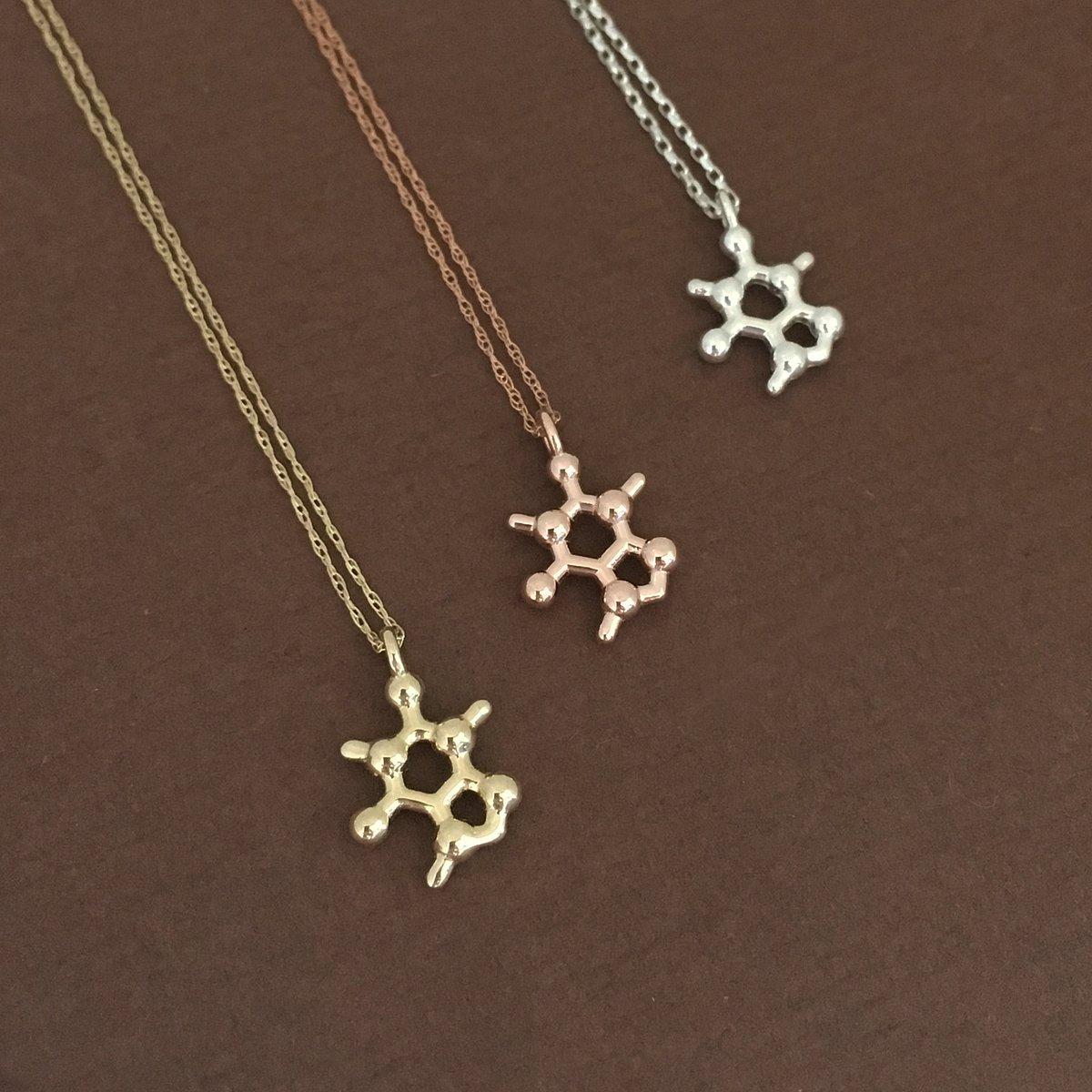 Image of tiny caffeine necklace
