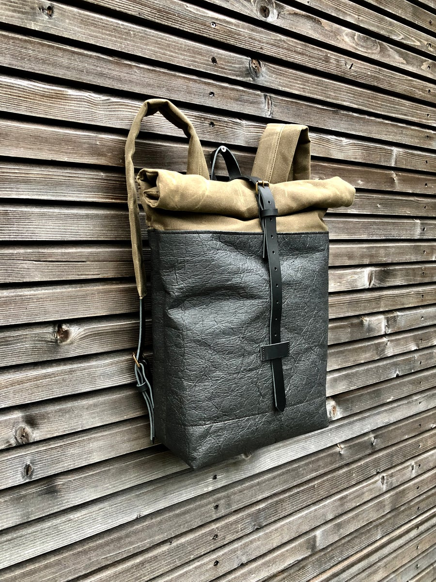 Image of Vegan backpack in black Piñatex™ and field tan waxed canvas with roll to close top