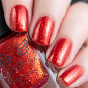 Image of  9 ¾  a orange toned red with red and gold aurora shimmer with metallic look and gold flecks