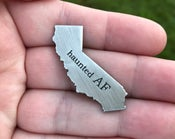 Image of The Skelton Crew Collection: States of Unrest California Haunted AF pin!