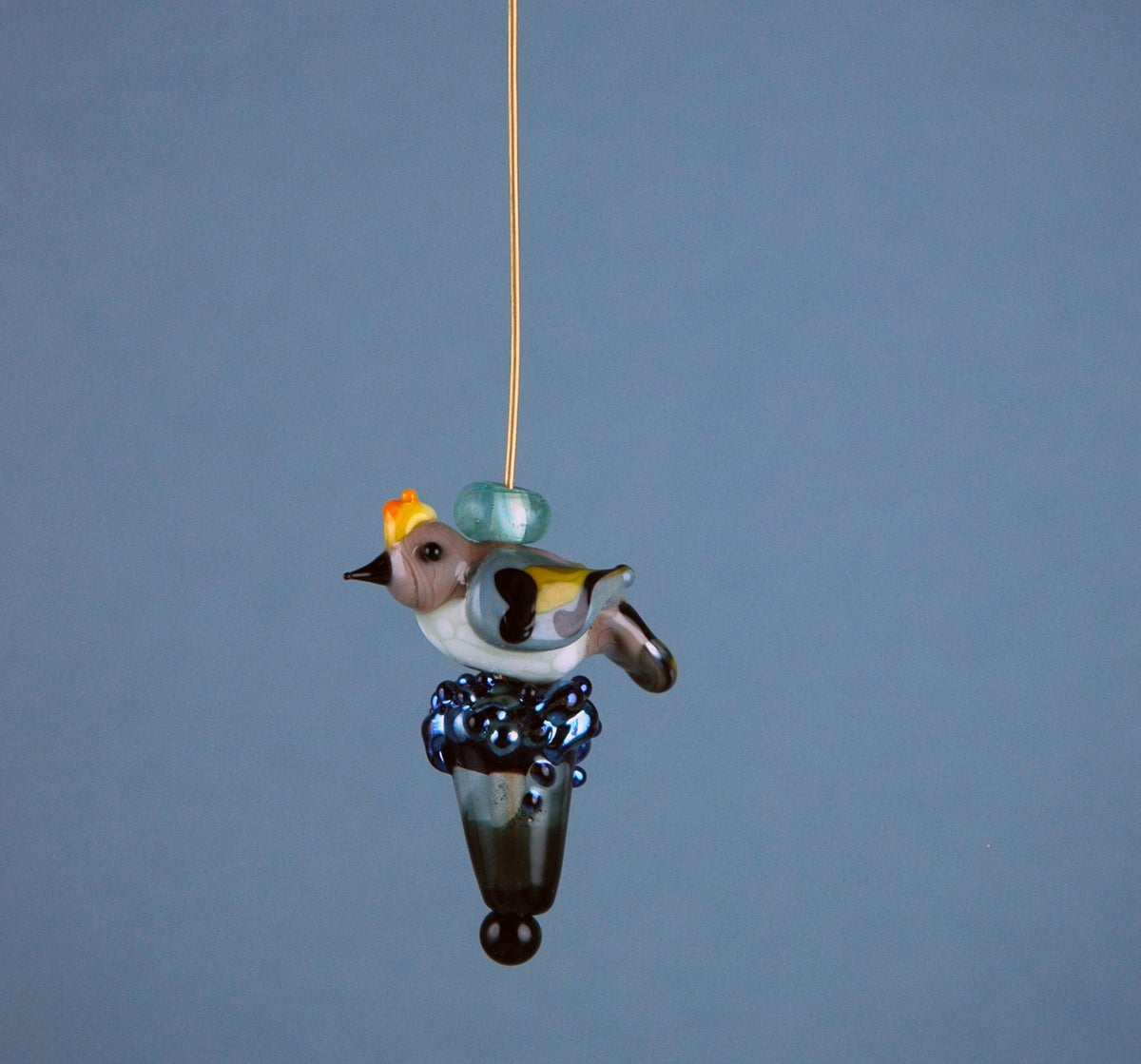 Image of Ruby Crowned Kinglet on a cone set & bail (5 beads)