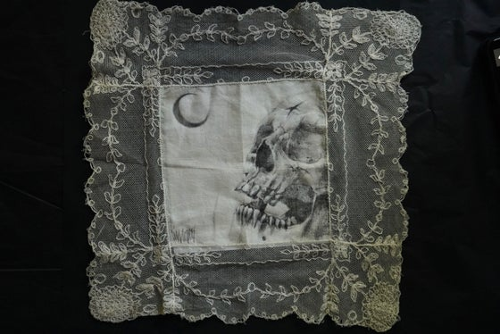 Image of graphite on antique lace