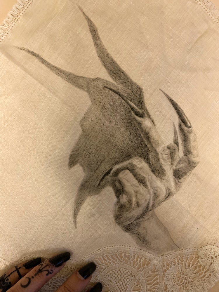 Image of Casting devil drawing on antique cotton and lace handkerchief