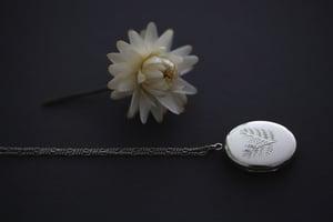 Image of fern leaf engraved locket