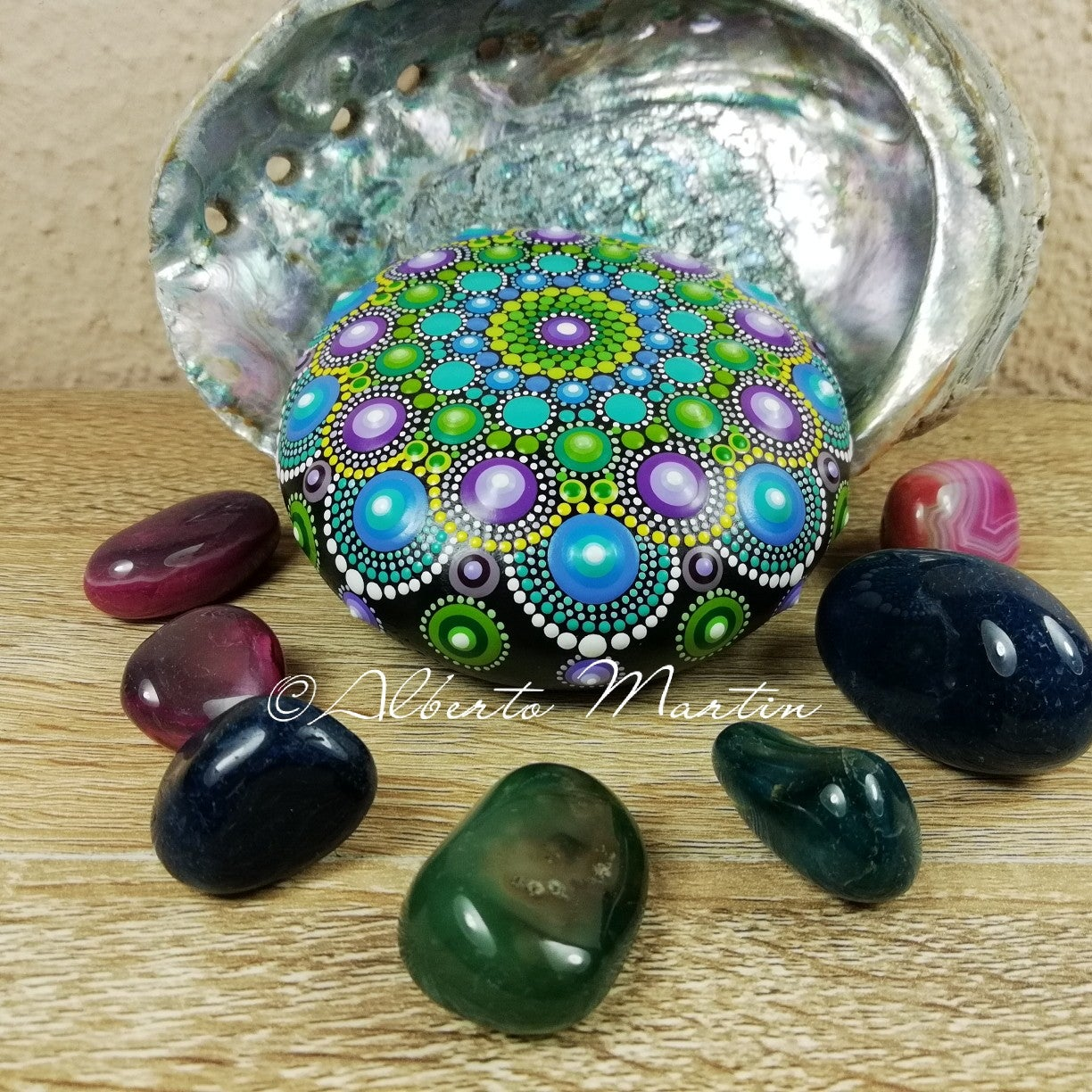 Image of Mandala painted stone. Purple, Blue and green.