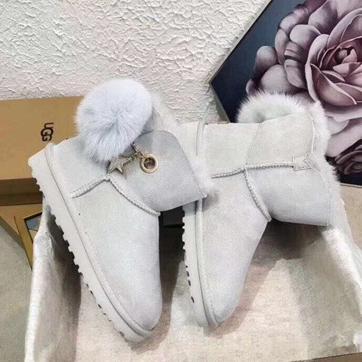 Image of Ugg Charm & Pom Boot