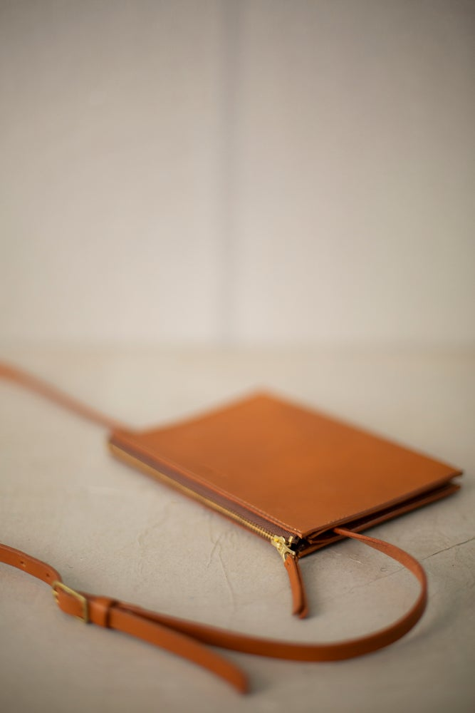 Image of Camel color leather shoulder clutch by Nejicommu