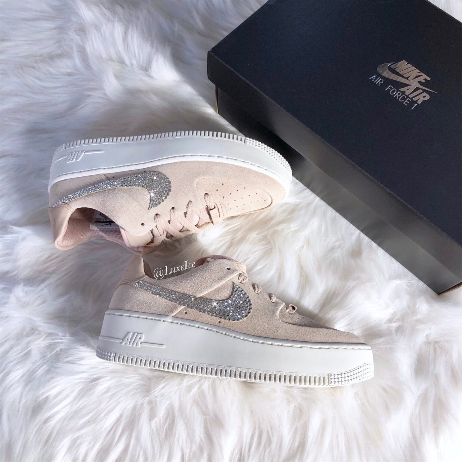 Image of Swarovski Nike Air Force 1 Sage Low customized with SWAROVSKI® Xirius Rose-Cut Crystals.