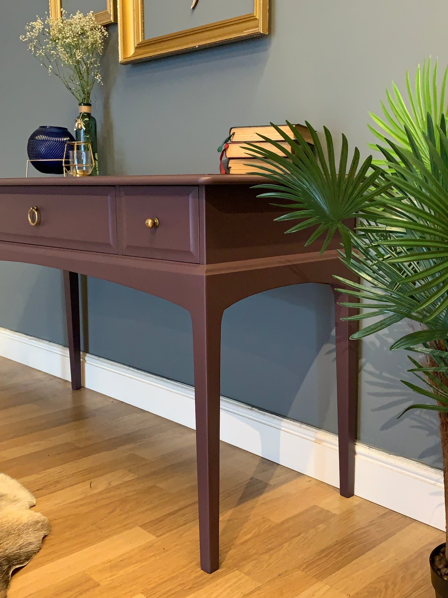 Image of A dark purple stag desk/dressing table