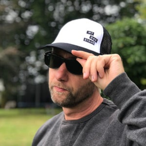 Image of Classic trucker black and white snap back cap