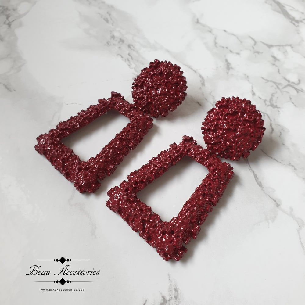 Image of Deep red textured earrings