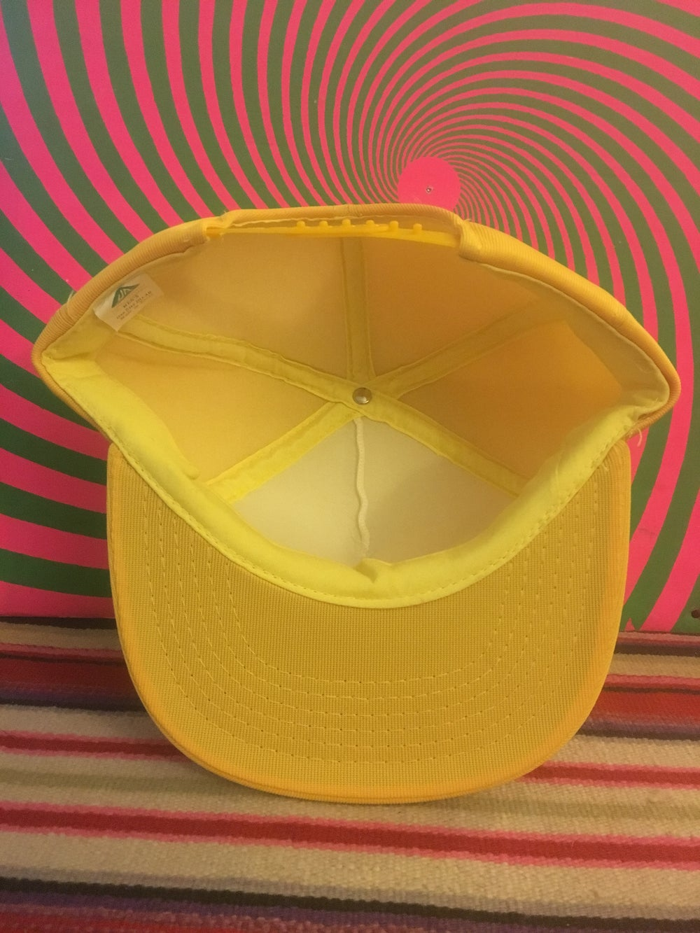 Image of yellow/white trucker hat w/ hella bat