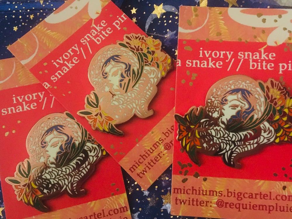 Image of ivory snake enamel pin