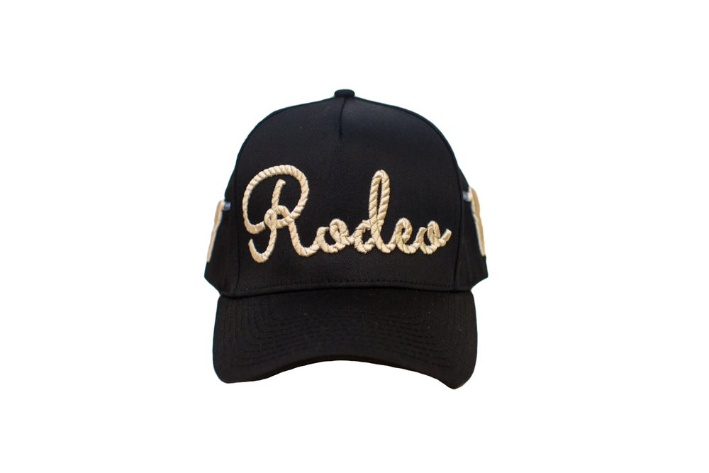 "Image of ""Rodeo"" Rope Black Trucker Hat"