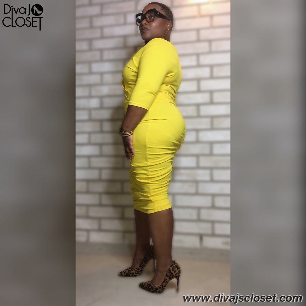 Image of Yellow Off The Shoulder Crop Top & Ruched Midi Skirt Set