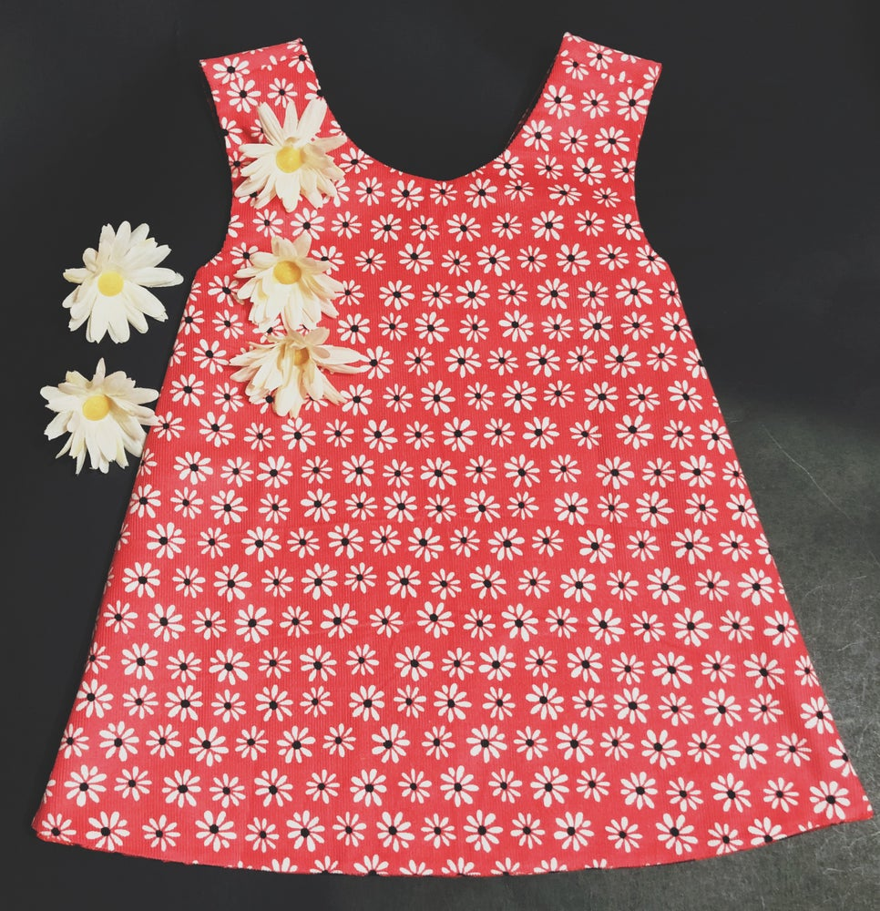 Image of Raspberry/ Pink Floral Corduroy Reversible Pinafore