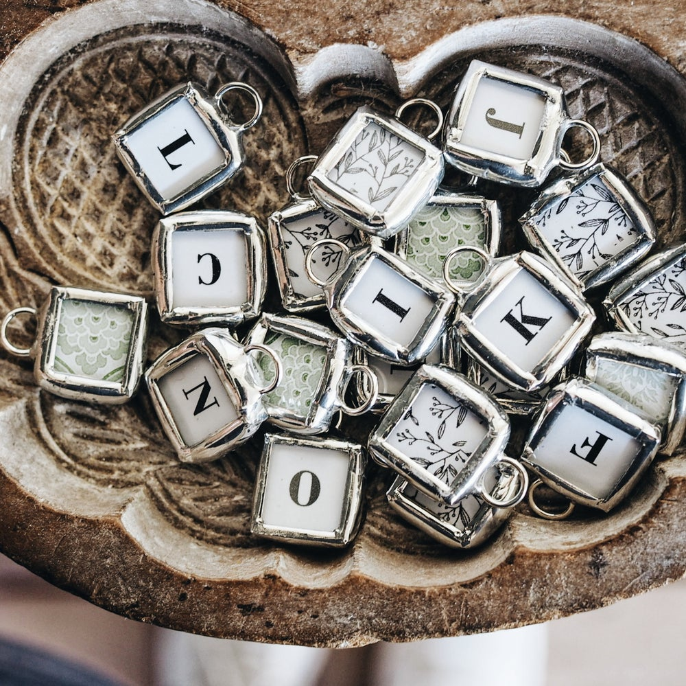 Image of tiny alphabet charms