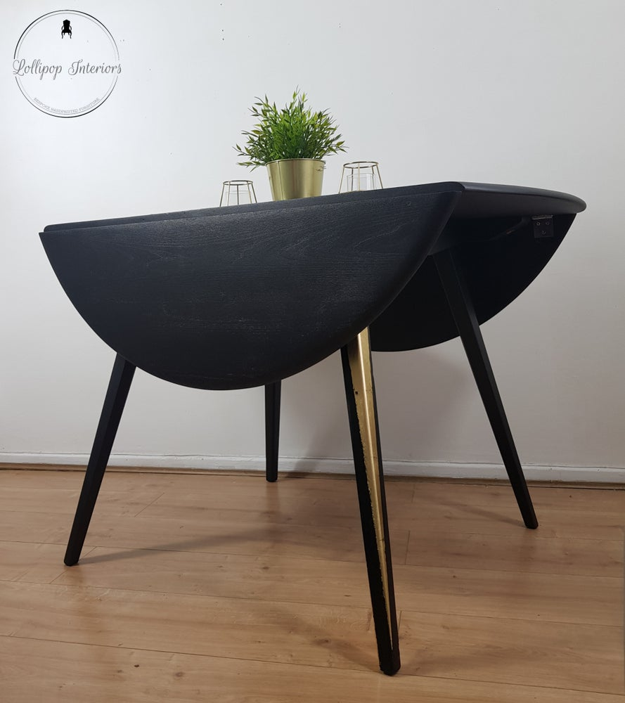 Image of ERCOL drop leaf dining table in black and gold